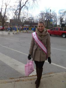 Before the parade began, a lovely Kate with a bag full of candy and a band in the background. :)